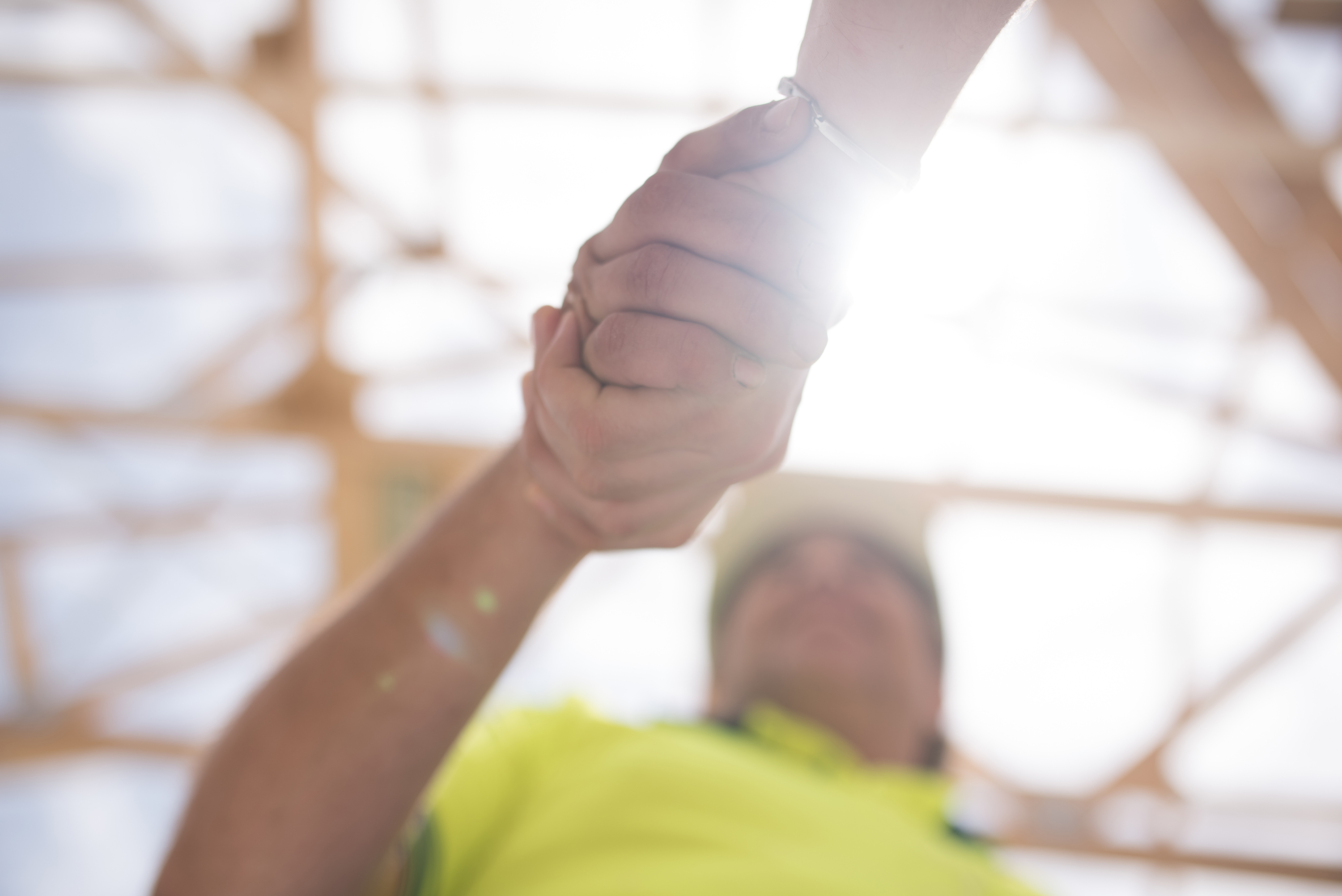 Close up of construction worker giving a handshake to manager of the objectt